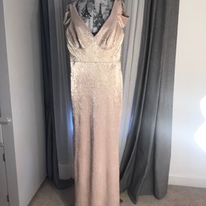 Long shimmery pink / silver evening dress .